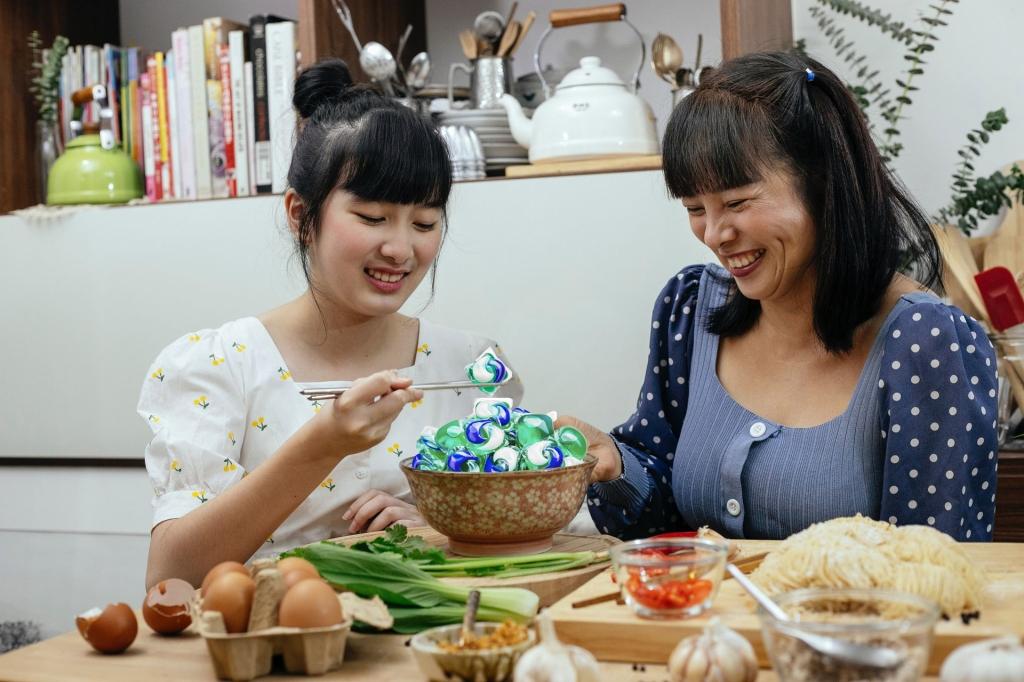 Two Asian women enjoy equate-brand tide pods with chopsticks.